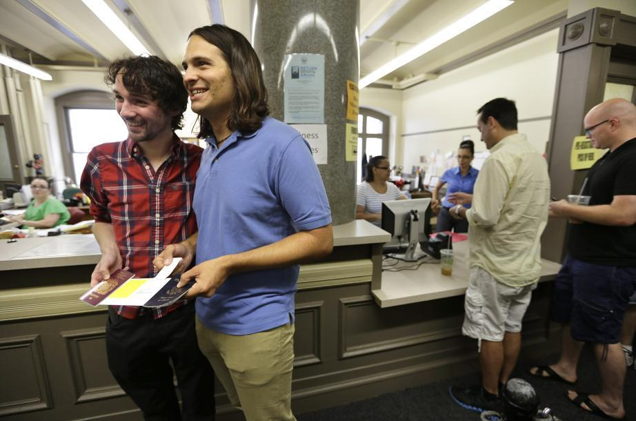Gary McDowell, left, and Zachary Marcus, both of Providence, R.I., displayed their newly obtained marriage certificate at City Hall in Providence.